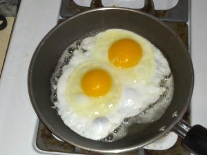 H and H Feed eggs in a pan